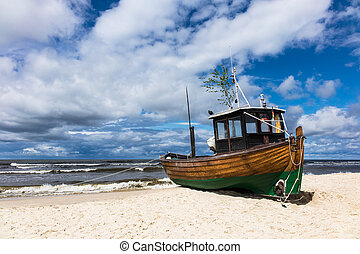 A fishing boat on shore of the Baltic Sea in Ahlbeck Germany...