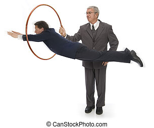 Jumping Through Hoops - CEO holding up a hoop for his...