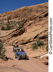 Off-Roading in Utah - 2 side-by-side ATVs coming down a dirt...