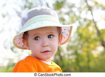 baby in hat outdoor