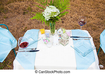 Serving table decoration on nature picnic outdoors