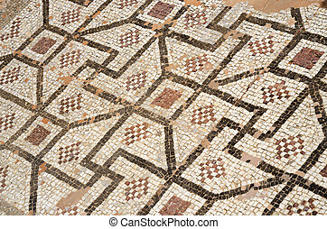 Mosaic floor of ancient roman villa with ancient geometrical...