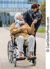 Disabled grandpa and granddaughter spending time outdoors