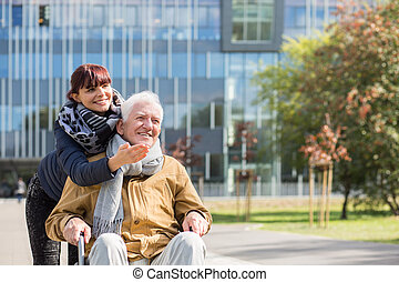 Disabled man on a walk with granddaughter