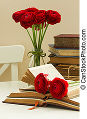 Old books with red flower - Pile of old vintage books with...