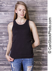 Female in tank top - Young female wearing plain black tank...