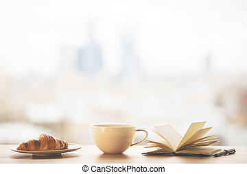 Desktop with mug and book - Desktop with round coffee mug,...