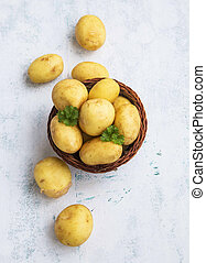 Young raw potatoes, organic golden vegetables