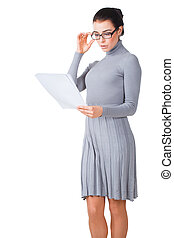 Surprised girl looking on paper, isolated on white...