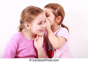 Kids whispering - Girl whispering a secret to her girlfriend