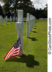 Flag and grave - Soldiers grave at the American cemetery in...