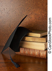 Graduation still life - Still life with graduation cap and...