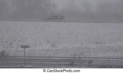 Truck on Highway During Snow Storm