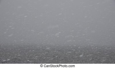 Snowstorm over Body of Water