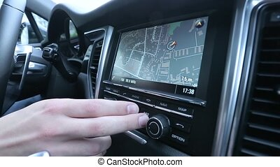 Man uses a navigator in the car.