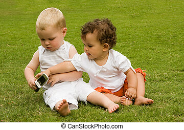 Jealousy - Jealous little girl wanting her brother\'s mobile...