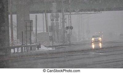 Traffic Under Bridge During Snow Storm