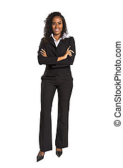 Young mixed race businesswoman with arms folded smiling.