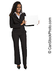 Happy African American business woman holding placard...