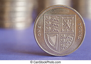 British pound coin - Close up of one british pound coin with...
