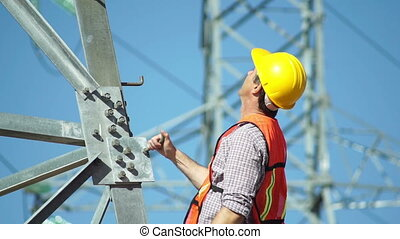 Electrical Tower Man Thumbs Up - Close up shot of a male...