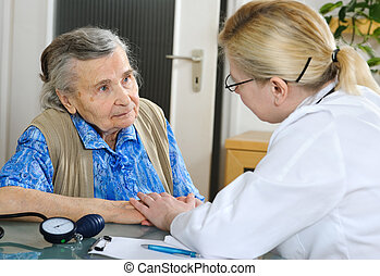 medical exam - An elderly women being examined by a doctor
