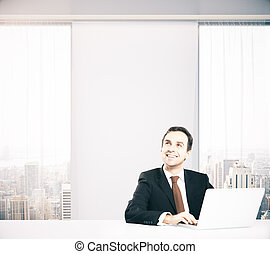 Thoughtful smiling businessman - Smiling businessman with...