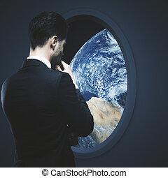 Businessman and dark spaceship window - Thoughtful...