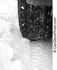 Old Truck Tire in Fresh Snow Rugged Tread
