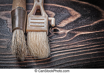 Age-old paintbrushes on wooden board horizontal version...