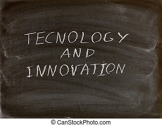 technology and innovation words written on a blackboard