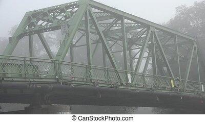 Bridge on Foggy Morning