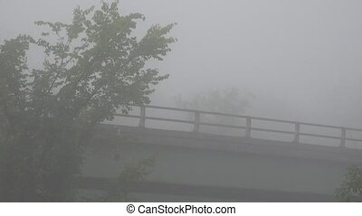Bridge Traffic on Foggy Morning