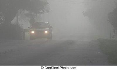 Car Driving Through Fog