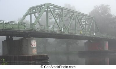 Bridge on Foggy Morning