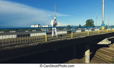 Saxophonist in the automobile bridge Aerial photography -...