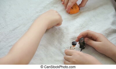 Boys playing in small toy cars at a kindergarten