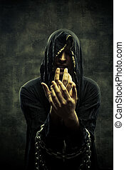 Chained cultist - Portrait of miserable chained young man in...