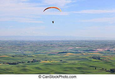 Para glider on rolling hills - Para glider up in the sky...
