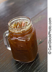 Iced Americano on wood table - Delicious ice coffee...