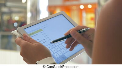 Writing Message in Tablet with Stylus - Closeup shot of...