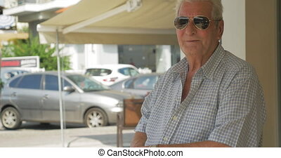 Senior Man in Sunglasses - Smiling senior man in sunglasses...