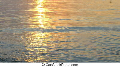 Quiet sea waves washing shore at sunset - Nature scene of...