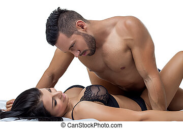 Portrait of bearded man and busty brunette in bed