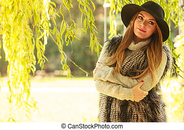 Attractive girl warm herself - Autumnal female fashion...