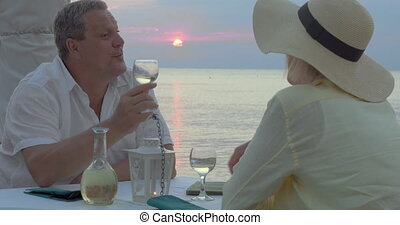Couple Having a Date at Sunset - Couple is having a date in...
