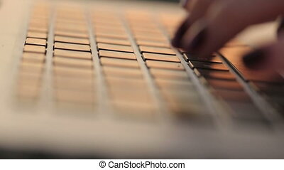 Close-up beautiful hands  of young businesswoman using laptop
