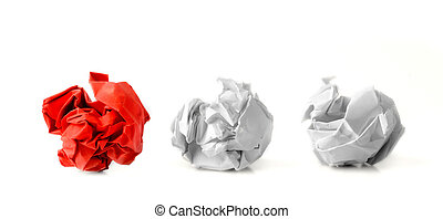 Three Paper Balls in a Row - Red paper ball next to two...