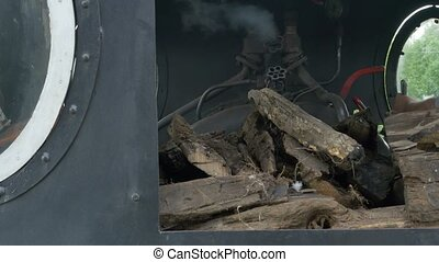 Steam Locomotive Cab and Levers - The train engine driver is...