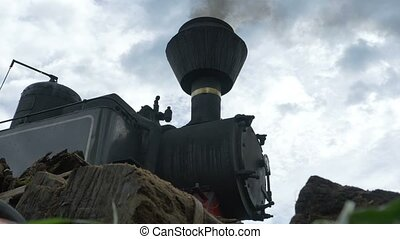 Smoke Box Steam Train - Low angle view of a steam locomotive...